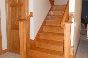 Birch stair case with oak trim by Blade Millworks