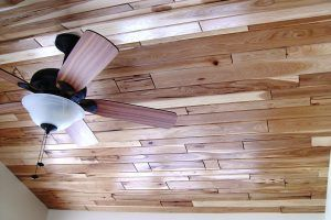 Cherry wood on the celing with a celing fan by Blade Millworks