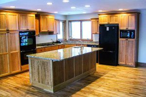 Blade Millworks remodeled kitchen with black appliances