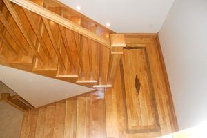 Red birch and walnut flooring by Blade Millworks